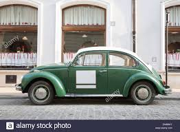 green volkswagen beetle green vw beetle car outside restaurant stock photo royalty free