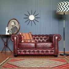 oxblood leather chesterfield sofa eclectic industrial vibe