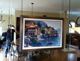 how to hang a painting oil painting on chain over mirror wall traditional living room