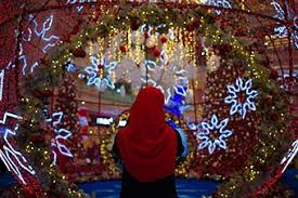 Christmas Decorations Shopping Malls Kuala Lumpur by A Woman Takes Pictures Of Christmas Decorations At A Shopping Mall