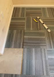 Laying Carpet On Laminate Flooring Our Basement Part 40 Installing Carpet Tile Stately Kitsch