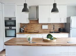 plan de cuisine ouverte sur salle à manger une cuisine ouverte sur la salle à manger toute de blanc et de