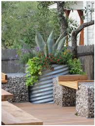 water trough planter galvanized metal containers in the garden apartment therapy