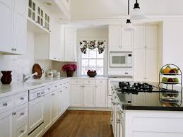 kitchen makeovers on a budget that upgrades your monotonous white kitchen makeovers on a budget with white cabinets and white and black granite countertop plus