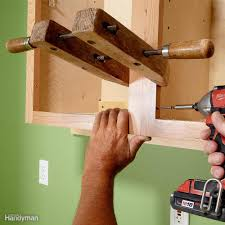 How To Level Kitchen Base Cabinets Install Cabinets Like A Pro Family Handyman
