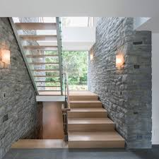 architecture contemporary interior design with wooden staircase architecture contemporary interior design with wooden staircase glass railing panels and stone clad wall ideas