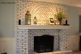 stylish painted brick fireplace with black paint color brick stone