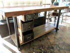 kitchen island made from reclaimed wood really like this idea plus if not needed for indoors it works