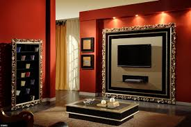 Tv On Wall Ideas by Luxury Living Room With Black Shiny Tv On The Wall With Orange