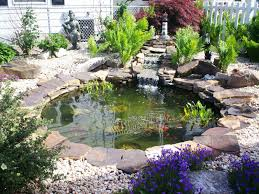 small garden with mini japanese ornament and pond maintenance