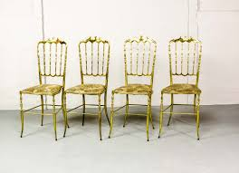 mid century set of polished brass chiavari chairs by giuseppe
