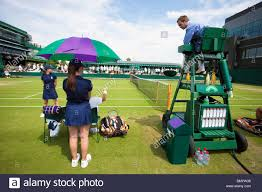umpire chair and ball boys and girls at wimbledon
