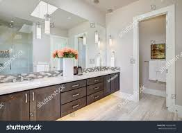 his and her bathroom contemporary master bathroom features dark dual stock photo