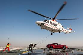 burj al arab images aston airlifts vanquish to burj al arab helipad motoring middle