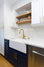 kitchen cabinets above sink navy and white galley kitchen cliqstudios