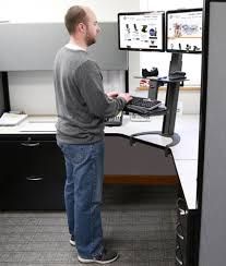 Sit To Stand Desk Health Postures Taskmate Go Sit Stand Desk Burn Calories At Work