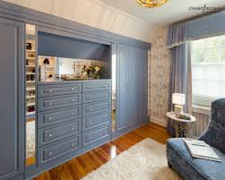 sporting blue built in drawers cabinets w mirrored inserts sporting blue built in drawers cabinets w mirrored inserts create a comfy cozy walk in closet out of a rarely used guest bedroom
