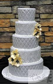 fondant iced wedding cake decorated quilting pattern a little