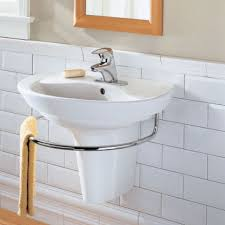 wall mounted sink with tpwel holder installed in the bathroom