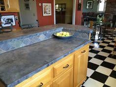 Harlequin Backsplash - a case for concrete counters concrete kitchens and modern
