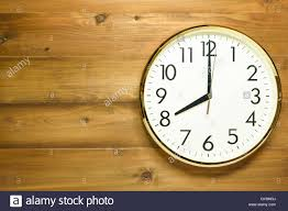 Wooden Wall Clock Wall Clock On The Wooden Wall At Time 8am Or 8pm Stock Photo