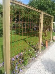 Trellis As Privacy Screen Inspire Your Garden With A Trellis Grape Arbor Arbors And Gardens