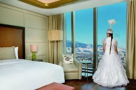 Bedroom Bed In Front Of Window Wedding Planning Information The Ritz Carlton Almaty