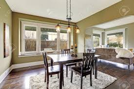 open floor plan dining area with dark brown dining table set