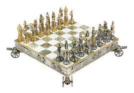vasari gilt metal chess set and board circa