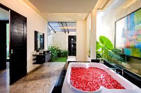 luxury modern bathroom with unique unframed mirror featuring