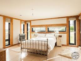 cozy master bedroom with exposed douglas fir timber frame in new
