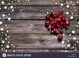 wooden rustic christmas background with red balls and as frame in