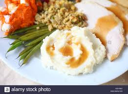 thanksgiving meal images thanksgiving meal with turkey mashed potatoes stuffing green