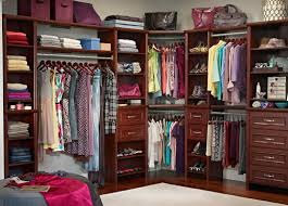classic bedroom decoration with wooden walk in closet organizers