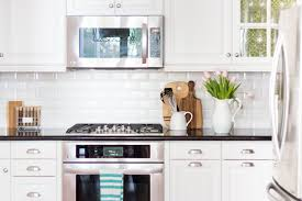 glass cabinets in white kitchen 5 tips on living with glass cabinets a thoughtful place