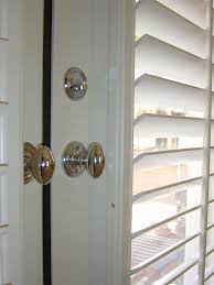 shutters on french doors with oval handles close up home decor