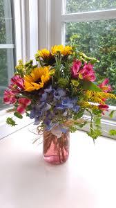 jar flowers seashell jar of flowers in newport or newport florist and