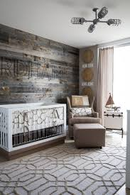 Nursery Decor Blog by This Subtle Travel Themed Nursery Features A Driftwood Wall Fused