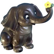 vintage josef originals large elephant holding yellow flower