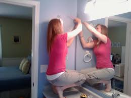 how to remove a mirror from bathroom wall