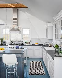 white kitchen with long island kitchens pinterest mix of materials in this bright blue and white kitchen in a beach