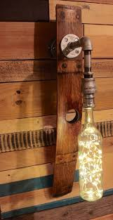 home theater wall sconce amazon com wine barrel and bottle wall sconce with led lighting