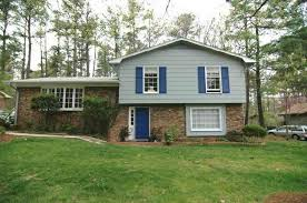 split level house style brick home with spacious screened porch low pitch doors and house