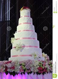 wedding cake with pink ribbon and flowers royalty free stock image