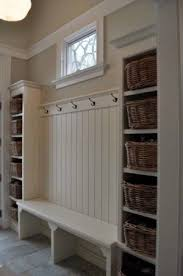 mudroom with built in bench seat wainscoting beadboard wall with