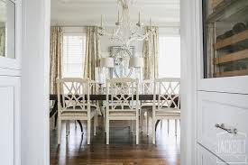 dark dining table with white dining chairs