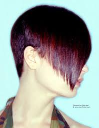 boyish hairstyle with a super short back and a warm red glow