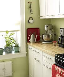 green and white kitchen ideas white cabinets butcher block countertops and green walls my