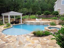 Lagoon Swimming Pool Designs by Pool With Pavilion Large Sunshelf Blue Lagoon Pebble Tec And 3