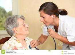 Home Nurse by Elderly Person With Nurse At Home Stock Photo Image 15453800
